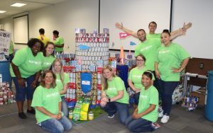Winning CANstruction team CanUDigIt with their canned good castle