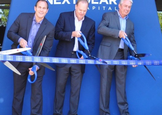 NextGear Capital President Brian Geitner, Cox Automotive GVP Patrick Brennan and NextGear Capital VP of Canadian Operations Roy Vandermeer cut the ribbon to open NextGear Capital's new Canada office.