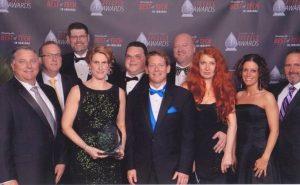NextGear Capital employees pose with their recently won Mira Award