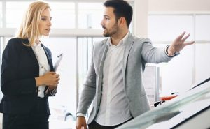 Used Car Dealer and Frustrated Customer in used car dealership