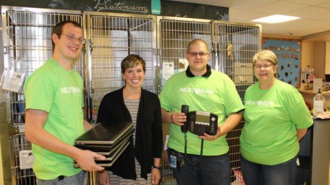 NextGear Capital team members present donations to the Humane Society of Hamilton County