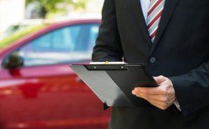 Floor plan finance company representative conducting an automotive dealership audit