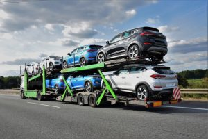 auto transporter transporting cars utilizing transportation financing