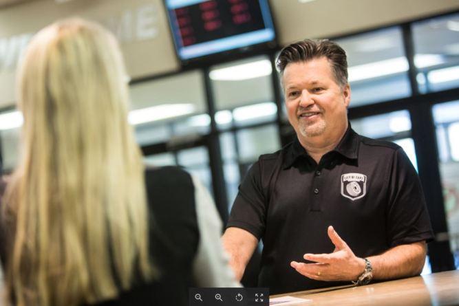 Car dealer discussing digital retailing tools