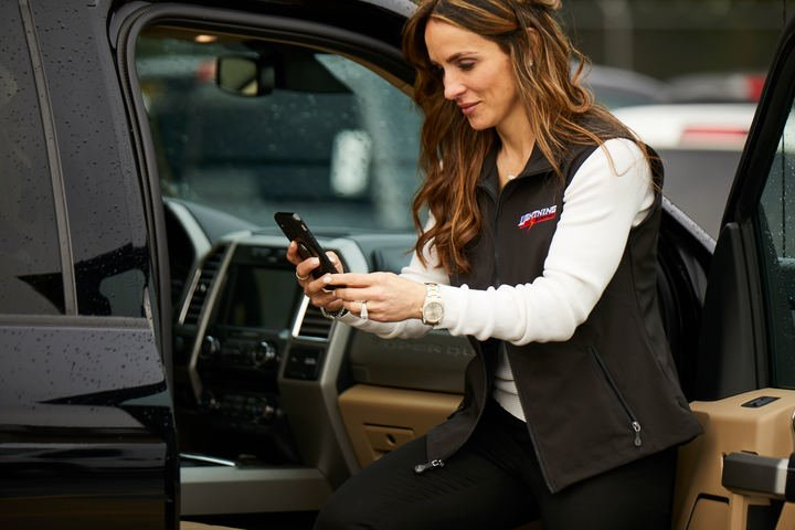 Dealer clearing audits from her mobile device