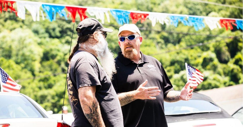 Car dealer speaking to a customer